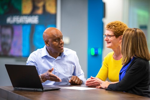 Photo of Sage colleagues, Bruce Hills and Michele Stotter, in office