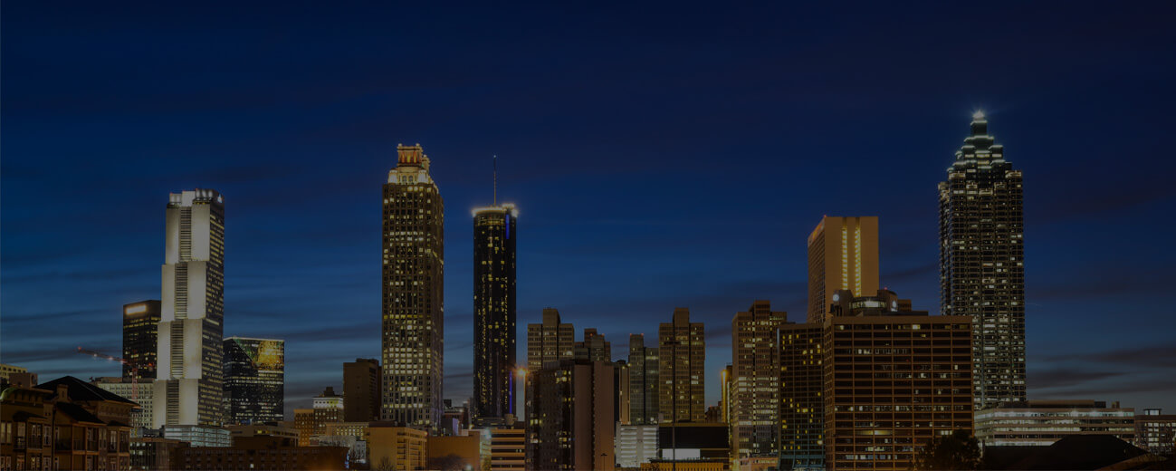 brightly lit cityscape at dusk